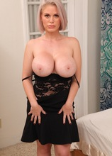 Blonde MILF Casca Akashova exposes massive tits and fingers her twat.