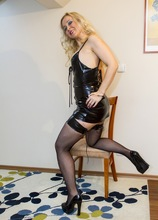 Blonde MILF Anesa Chance sniffs heels and plays with handcuffs.