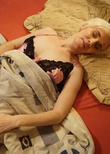 Sleepy mature amateur Dorena wakes up and fingers her hairy pussy.