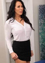 Busty mature babe Reagan Foxx undresses after work at the office.