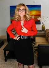Busty mature cougar Nina Hartley in sexy black stockings.
