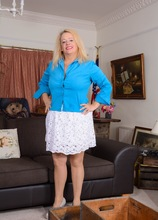 BBW English housewife Erotica Ann toys her pussy on the sofa.