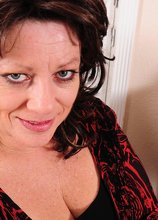 Thick mature wife Cheryll Stone licks her big tits.