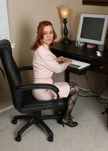 Redhead office girl looks great naked at AllOver30