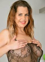 Busty mature Lauren James with lingerie shows off her shaved pussy at AllOver30