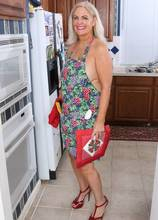 Hot mature Judy Mayflower shows off her shaved pussy in the kitchen at AllOver30