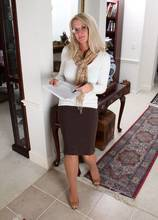 Blonde MILF Ingrid gets out of her office clothes at AllOver30