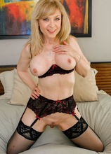 Older mature babe Nina Hartley gets her pussy pounded hard.